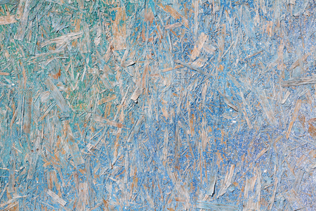 Colorful (turquoise, blue and yellow) painted OSB board as background, texture Stock Photo