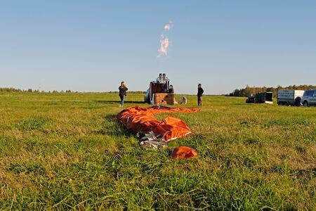 Pereslavl-Zalessky, Russia - September 23, 2017: Crew of a hot air ballon preparing before flight at the festival of aeronautics in Pereslavl-Zalessky