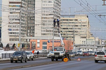 Volgograd, Russia - 28 December, 2018: Workers on the crane install and decorate the Astrakhan bridge with led light in Volgograd Editorial