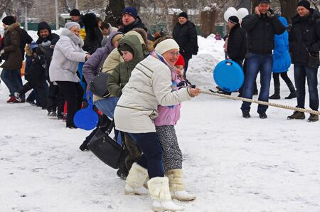 Moscow, Russia-February 25, 2012: People playing the national festival Editorial