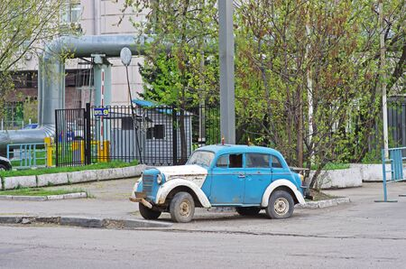 Moscow, Russia - April 29, 2012: White-blue abandoned old Moskvich-401 car standing on the street of Moscow