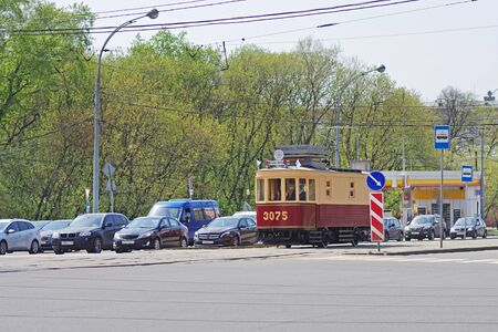 Moscow, Russia - May 02, 2018: Old restored tram car in modern city traffic in Moscow
