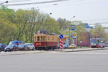 Moscow, Russia - May 02, 2018: Old restored and new trams in modern city traffic in Moscow