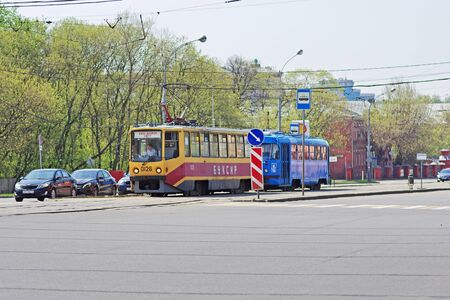 Moscow, Russia - May 02, 2018: A special tram-tug tows a faulty tram along a city street in Moscow