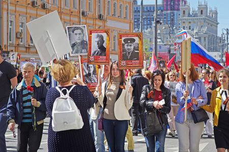 Moscow, Russia - May 09, 2018: People hold portraits