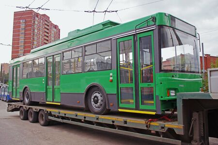 Russia, Vidnoe(Moscow region) - September 03, 2013: Transportation of trolleybus on the platform using tow tractors of KAMAZ truck in Vidnoe. Editorial