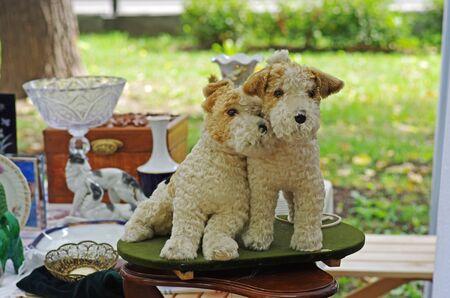 Vintage toys of foxterriers at a flea market