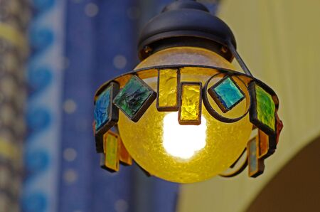 Suspended street lamp made of metal and colored glasses