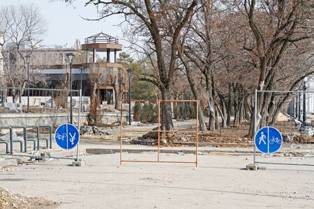 Volgograd, Russia - March 09, 2019: Fences with the sign for pedestrians and cyclists against the background of the park reconstruction in Volgograd Editorial
