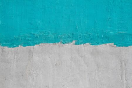 Colorful (gray and turquoise ) concrete wall as background, texture