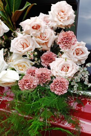A bouquet of beautiful roses, carnations, asparagus and gypsophilas at the spring festival