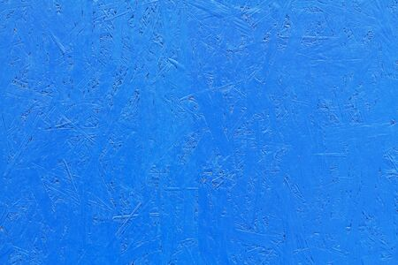 Blue painted OSB board as background, texture Stock Photo