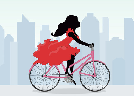 red dress: A woman rides a Bicycle on the background of the city.