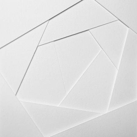 Abstract geometric background in light tones from sheets of thick white paper, cardboard. Suitable as design element, separate project for your project, cover for website. Square orientation. 스톡 콘텐츠