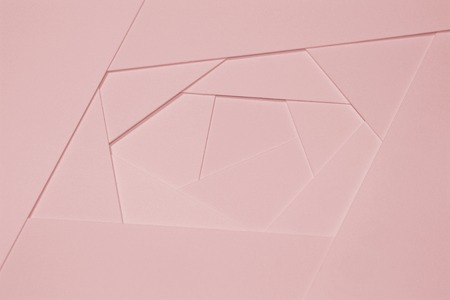 Abstract geometric background in light pastel tones from sheets of thick pale pink paper, cardboard. Suitable as design element, separate project for your project, cover for website. Horizontal.