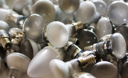 Disposal of used energy saving lamps, old spent bulbs. Foto de archivo - 107353606