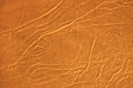Brown skin texture, natural or faux leather Фото со стока