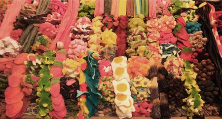 Colorful sweets at La Boqueria market in Barcelona, Spain.