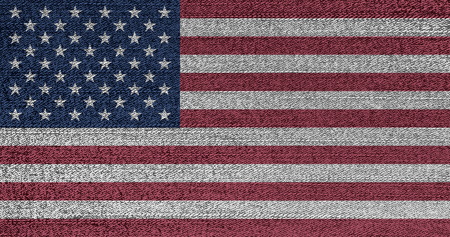 Grunge faded flag of USA. Isolated American banner on denim fabric. Rustic vintage style.