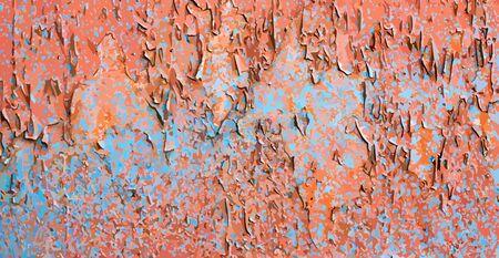 Shabby orange wall with blue spots. 免版税图像