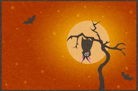 Cute grey bat hanging on dry tree on  of full moon.