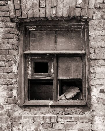 The window frame of a ruined house.