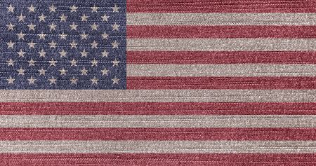 Grunge faded flag of USA. Isolated American banner on denim fabric. Фото со стока