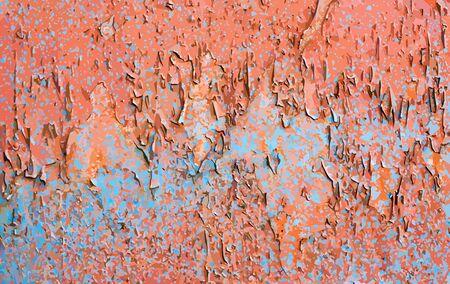 Shabby orange wall with blue spots. 矢量图像