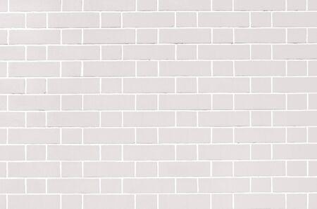 White brick wall. Light grey background of masonry. Texture stained blocks of stonework. 免版税图像