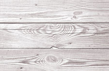 Background of white wood boards. Wooden flooring, timbered floor, light covering. Rustic backdrop of old panels with nails. Vintage wooden texture of fence. Natural pattern for wallpaper.