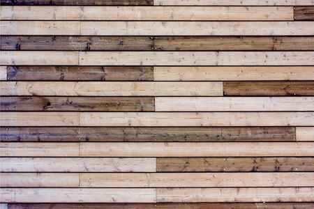 Deck of wooden board. Background lumber pattern. Texture wood wall of brown timber panels.