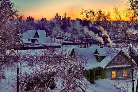 Night village in winter.  It is cold - to fire a furnace.
