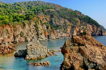 A rocky shore of the Mediterranean Sea and forbidding bay.