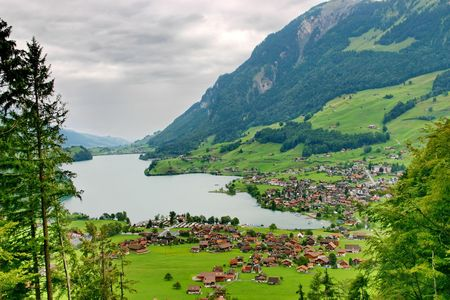 Switzerland.The village near mountain lake