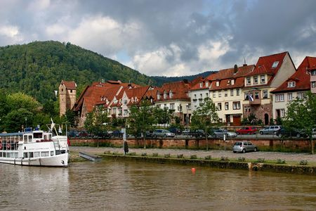 The stroll on the boat. The township and green the hill on the beach of the river Stock Photo