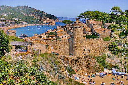 Mediterranean Sea. The old  stronghold by the sea guards mouth of harbour
