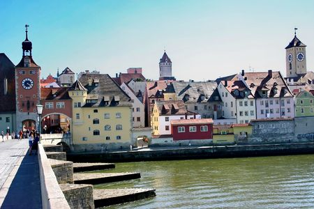 The view of the town Regensburg and the old stone bridge across Danube.