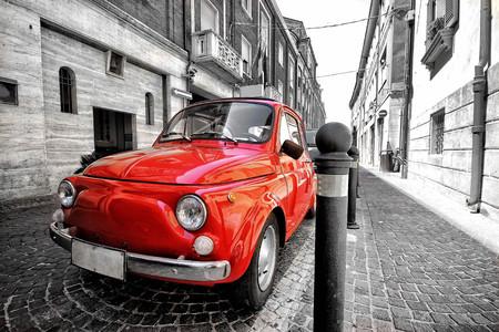 Red fiat 500 old vintage car in italy on a black and white background color splash postcard like photo Redakční