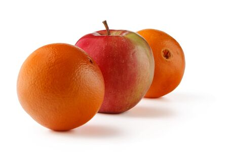 Orange cut in half and Apple isolated on white background