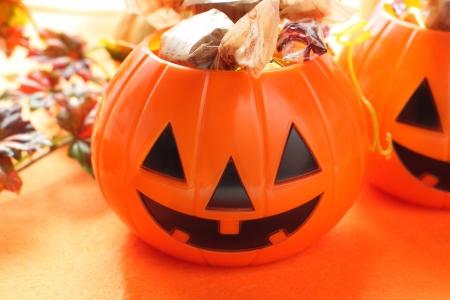 Halloween candies and orange pumpkin Stock Photo - 17641839