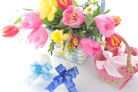 Easter table decorations with spring flowers and easter eggs photo