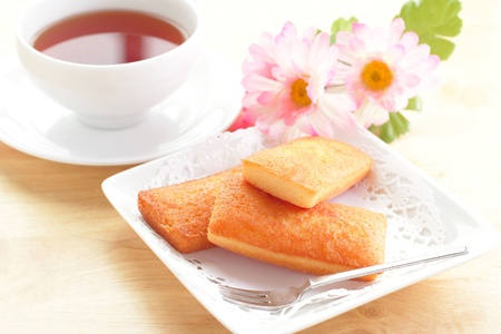 financier: French biscuits called Financiers, with almond powder, smooth inside and crispy on the edges Stock Photo
