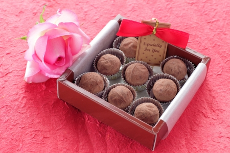 chocolate truffle over red background photo