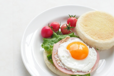 English Muffin with ham and fried egg photo