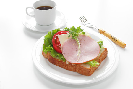 Healthy open sandwich with lettuce, tomato, ham and cheese isolated on white  Stock Photo