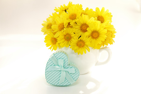 bouquet of yellow mums in vase isolated on white background photo