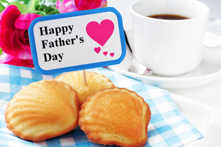 Madeleine cake with elegant flower for fathers day photo