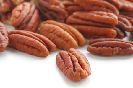 crunchy: Peeled pecan nuts close up, isolated on white background