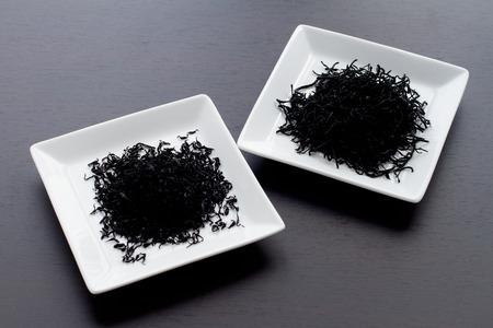 dietary fiber: japanese food ingredient, dried Hijiki brown seaweed in bowl with copy space for dietary fiber image
