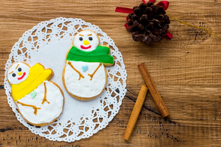 snowman wood: Snowman Cookie on Wood Background